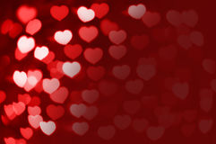 Red and white hearts bokeh as background with copy space Royalty Free Stock Photos