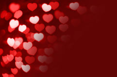 Red and white hearts bokeh as background with copy space Royalty Free Stock Photo