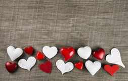 Red and white hearts on wooden background for a greeting card: c Royalty Free Stock Photos