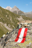 Red and white hiking marker on rock in Austrian Alps. Closeup of red and white hiking marker on rock in Austrian Alps Stock Images