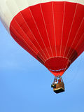 Red and white hot air balloon rising Stock Photography