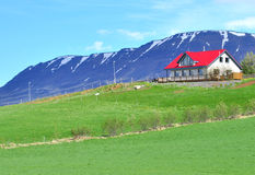 Red white house in mountains Stock Photography
