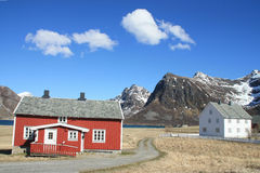 Red and white houses of  Flakstad Stock Photography