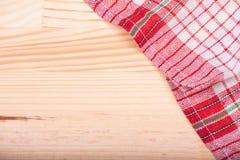 Red white kitchen napkin natural light background Royalty Free Stock Photos