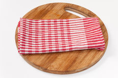 Red white kitchen towel on the wooden board Stock Photos