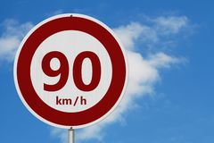 Red and white 90 km speed limit sign stock photo
