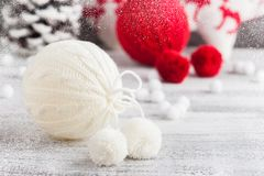 Red and white knitted balls. Christmas decoration royalty free stock photos