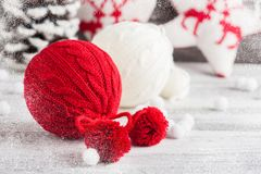 Red and white knitted balls. Christmas decoration stock images