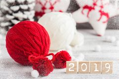 Red and white knitted balls. Christmas decoration stock image