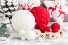 Red and white knitted balls. Christmas decoration stock photo