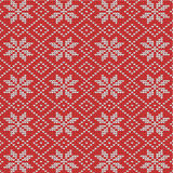 Red and white knitted snowflakes background Royalty Free Stock Photo