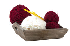 Red and white knitting wool on a wooden tray Royalty Free Stock Photo