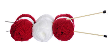 Red and white knitting yarn and needles Stock Photography