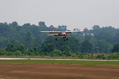 Red and White Landing. Small plane landing Royalty Free Stock Photo