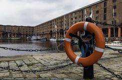 A red and white lifebelt with the the Albert Dock Liverpool in t. He background May 2018 Stock Photo