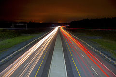 Light Streaks on Highway. Red and white light streaks from vehicles on highway Royalty Free Stock Photo