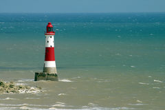 Red and white lighthouse. Lighthouse guarding dangerous rocks at beachy head, sussex, England Stock Photography