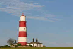 Red & white lighthouse. Set on hilltop Stock Image