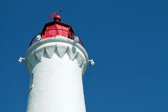 Red and White Lighthouse Against a Blue Sky Royalty Free Stock Images