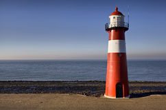 Red-white lighthouse on the coast of North Sea at Westkapelle Royalty Free Stock Photo