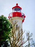 Red and White Lighthouse at La Rochelle, France stock photography