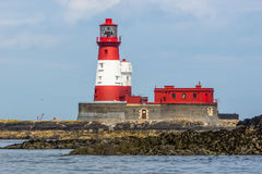 Red and white lighthouse Stock Photography