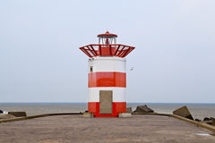 Red and white lighthouse in the Hague, Holland Royalty Free Stock Photo
