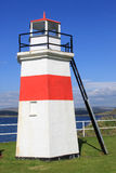 Red and white lighthouse at NW end of Crinan canal Royalty Free Stock Photo