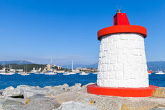 Red and white lighthouse tower, Corsica, France Royalty Free Stock Photography
