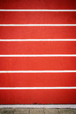 Red and white lined plaster wall Royalty Free Stock Photo