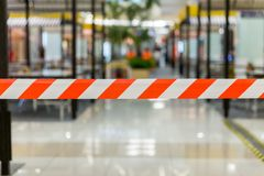 Red and White Lines of barrier tape. Striped, red and white tape that forbids passage. Red White warning tape pole fencing is protects for No entry stock photos