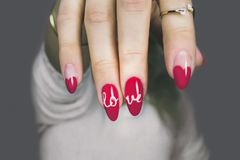 Red and White Manicure With Love Print Stock Photography