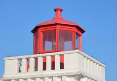 Red and White Maritime Beacon Light. The top of a traditional red beacon light used for maritime safety Stock Photo