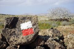 Red and white marks. On the rock near trail on the Fuerteventura island, Spain stock photo