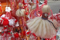 Red and white martenitsi on outdoor market for martenici on the street. Martenitsa or martenitza is given on 1st March as a symbol Stock Images