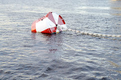 Red and white metal mooring buoys. Stock Image
