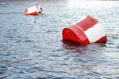 Red and white metal mooring buoys. Stock Photo
