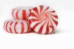 Red and white mint hard candy. Red and white circular mint hard candy sweet Royalty Free Stock Photos