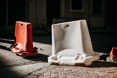 Red and white mobile plastic water filled barriers for temporary limit no access work zone. royalty free stock image