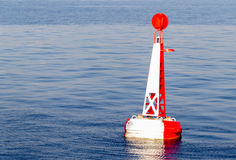 Red white moored buoy Royalty Free Stock Photography