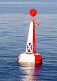 Red white moored buoy Stock Photos