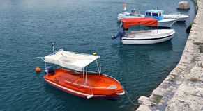 Red white moored motor boats Royalty Free Stock Images