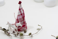 Red and white napkin folded,  forming a Christmas tree Stock Images