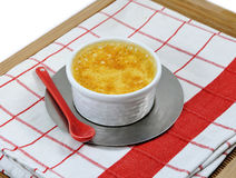 Red and white napkin with a home-made custard Stock Photos
