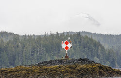 Red and White Navigation Marker on Alaskan Coast Royalty Free Stock Photo