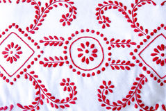 Red and white needlework Stock Photo