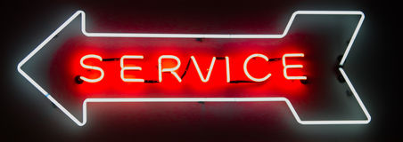 Neon Service Arrow Sign Stock Photography