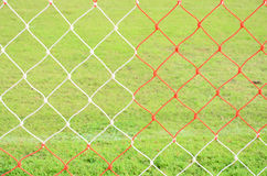 Red and white nets of football goal Stock Images