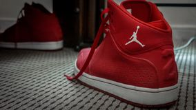 Red and white Nike MJ 23 basketball sneakers royalty free stock photos