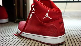 Red and white Nike MJ 23 sneakers royalty free stock images